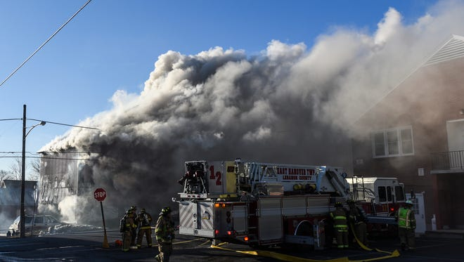 Fire crews battle a two-alarm fire in the 100 block of west Market Street in Jonestown on Tuesday, Feb. 14, 2017.