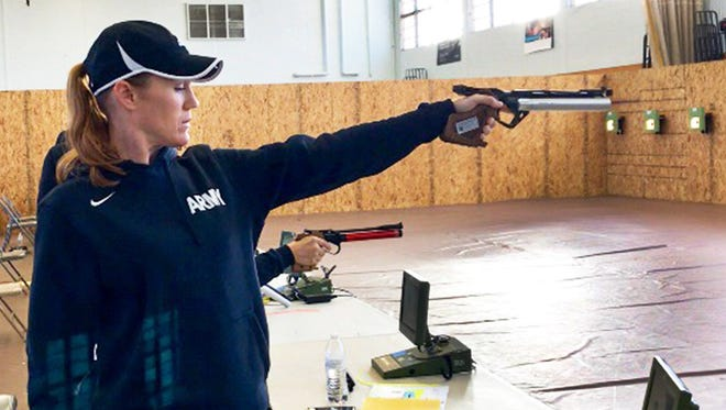 Maj. Christina Truesdale, of Fort Benning, Ga., aims for the small target while warming up before the start of air pistol shooting at the Army Trials on Wednesday at Fort Bliss. The event is a qualifier for the Department of Defense Warrior Games.