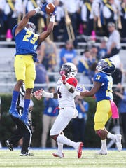 Delaware defensive back Nasir Adderley snags an interception in the second quarter in front of Richmond receiver Cortrelle Simpson and fellow defensive back Nijuel Hill at Delaware Stadium.