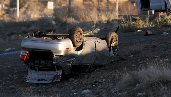 A vehicle lies overturned adjacent to East Broadway Avenue just west of Cortland Drive in Farmington on Saturday. One man was killed in the crash.