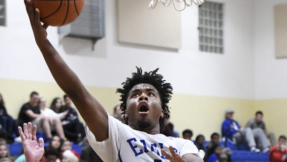 Eastside senior Pantry McKinney (11), shown during a game last season against Mauldin, scored 21 points in the Eagles' 64-60 win over Clinton Monday night in the Greenville County Tip-Off Tournament at Eastside.