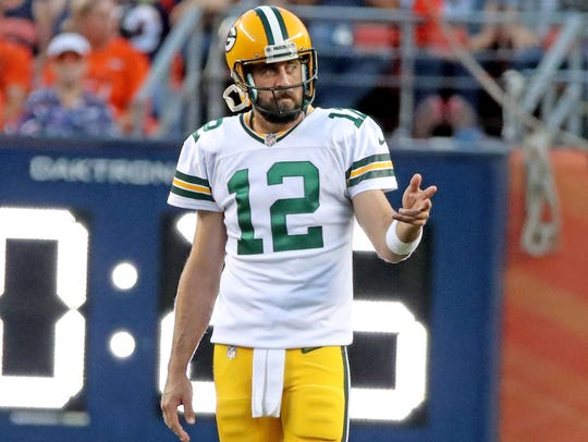 Green Bay Packers quarterback Aaron Rodgers (12) gestures