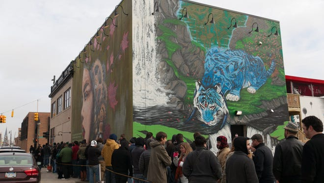 Elaborate murals, all painted by Detroit artists, highlight the West Canfield side of HopCat Restaurant and Craft Beer Bar on Woodward Ave in Midtown on Saturday, December 13, 2014.