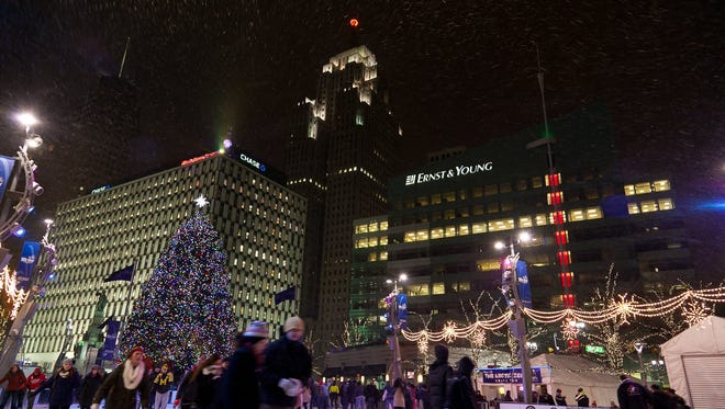 Frigid temperatures and snowy skies did not stop the celebration during The Drop, downtown Detroit's New Year's Eve celebration at Campus Martius Park on Tuesday December, 1, 2013. The free, family friendly event added a second, early Kid's Drop of the big D atop the Chase Tower for the younger revelers and plenty of ice skating and winter cheer for all. Entertainment was provided by DJ Thomas 'Tom T' Thankachan and hostess Ashley Elyse. The duo helped keep the stage busy with a variety of guests, entertainment and a wedding ceremony to ring in the new year.