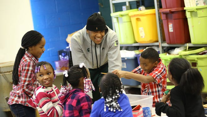 MSU basketball player Alvin Ellis interacts with kids while volunteering at the Flint Boys and Girls Club earlier this month.