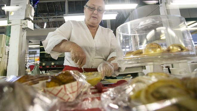 Nana's Oven owner Deb Volker, mixes up some buttercream icing Tuesday, March 29, 2016, at Market and Penn Farmers Market. Nana's, along with Generations, are two new booths that have recently opened at the market. Amanda J. Cain photo