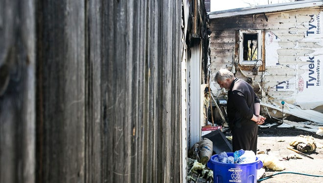 Homeowner Ivar DeJong, looks down as he surveys the damage to his house in Lower Windsor Twp. Saturday, April 16, 2016. The fire claimed the lives of seven dogs and is still under investigation. Amanda J. Cain photo