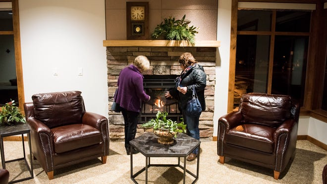 """Parish members admire the """"Fireside Room"""" in the new parish center at Immaculate Conception Church on Wednesday, Feb. 8, 2017, in Stayton. The church formally dedicated the new center following a the Eucharistic Celebration."""