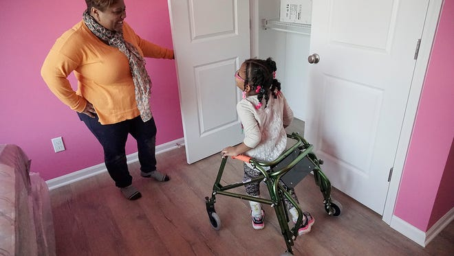 Six year old Lola, and her mom Nicole Addison, check out the closet space in Lola's new bedroom.