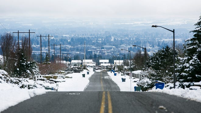 Snow covers the sides of Eola Drive NW in West Salem on Monday, March 6, 2017. Frost dates are coming later and winter leaving sooner across the Northwest.