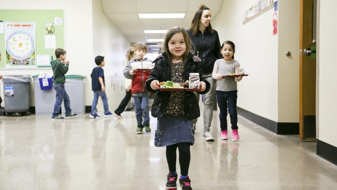 Kindergarten students at Chapman Elementary School carry their lunches back to their classroom on Wednesday, March 15, 2017. The Citizens Facilities Task Force presented its recommendations on overcrowding to the Salem-Keizer School Board Tuesday evening; Chapman was identified as a school in need of updates, including their lack of a cafeteria.