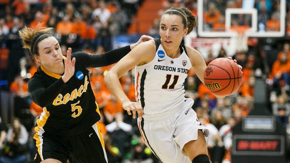Oregon State's Gabriella Hanson (11) dribbles past Long Beach State's Gigi Hascheff (5) in the first round of the 2017 NCAA Division I Women's Basketball Championship on Friday, March 17, 2017, at Oregon State University in Corvallis, Ore.