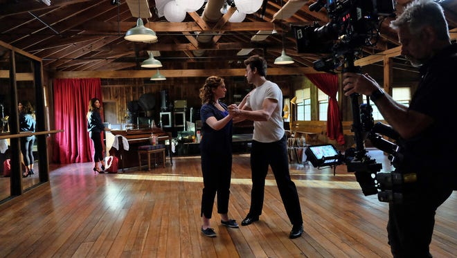 """Nicole Scherziner, Abigail Breslin and Colt Prattes on set in Western North Carolina for """"Dirty Dancing."""" Tune in to ABC at 8 p.m. May 24 to catch the movie's premiere."""