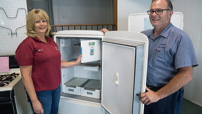They don't build them like this anymore (the 60-year-old General Electric fridge, not Carmack Appliance owners Shelly and Shawn Gagnon).