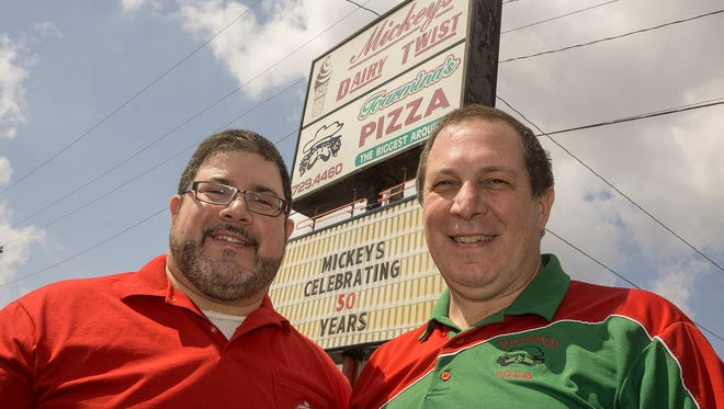 Brothers Frank Toarmina and Lou Toarmina share a building on Wayne Road in Westland. Lou (at right) owns Toarmina's Pizza and Frank bought Mickey's Dairy Twist from their father. Mickey's celebrates 50 years in business.