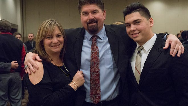 Tim Baechler, pictured with wife Julie and son Lou, was named Salem's fulltime activities and athletics director Tuesday night. Not pictured is Baechler's oldest son Brocton.