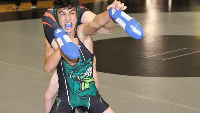 Action from the District 2A-12 wrestling meet at Mariner on Saturday.