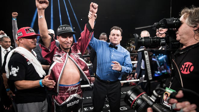 Mikey Garcia celebrates after winning a title in his fourth weight class Saturday night, beating Sergey Lipinets.