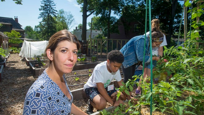 Marissa Staffen, a Rutgers' county 4-H agent in Essex County, helps run 4-H summer camp at the Montclair Community Garden.