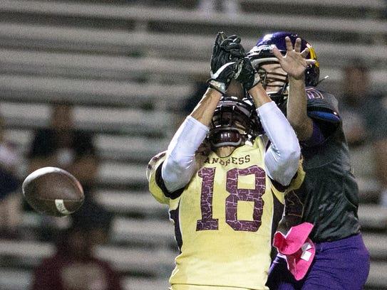 Andress wide receiver Antonio Gomez, 18, is caught