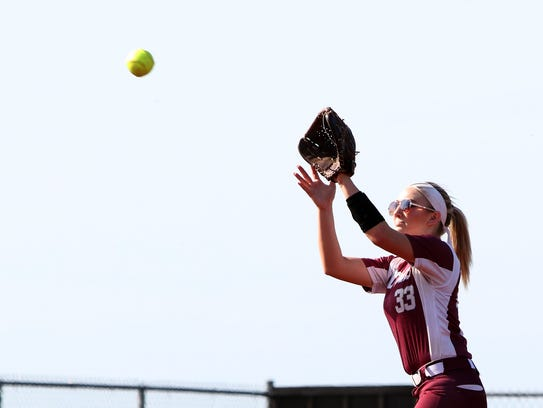 Bowie's Taylor McCarty catches the popup for the out