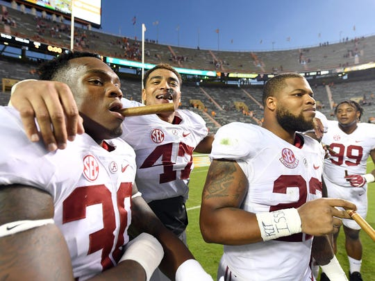 Oct 15, 2016; Knoxville, TN, USA; Alabama Crimson Tide linebacker Mack Wilson (30) , linebacker Christian Miller (47) , linebacker Ryan Anderson (22) and defensive lineman Raekwon Davis (99) celebrate their 49-10 victory with a traditional victory cigar after defeating the Tennessee Volunteers at Neyland Stadium. Mandatory Credit: John David Mercer-USA TODAY Sports