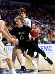 Bowen Born of Norwalk drives to the basket during the