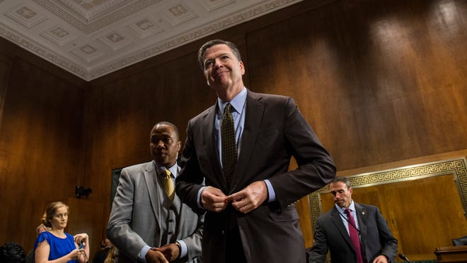 Director of the Federal Bureau of Investigation, James Comey leaves after testifying in front of the Senate Judiciary Committee during an oversight hearing on the FBI on Capitol Hill May 3, 2017 in Washington, DC.