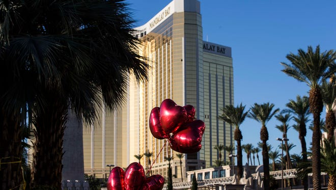 Las Vegas police block the streets near the Mandalay Bay hotel where some residents put balloons and flowers in  memory of victims on Oct. 3, 2017.
