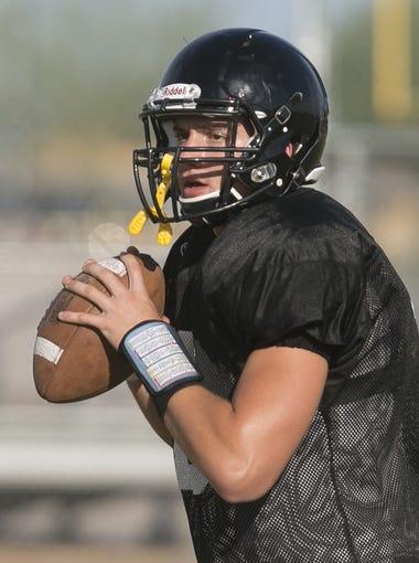 Desert Ridge's Dylan Wright looks for open receivers during practice at Desert Ridge High School in Mesa, AZ on August 10, 2015.
