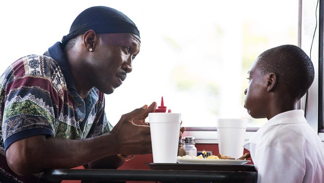 """Juan (Mahersha Ali) takes young Chiron (Alex Hibbert) under his wing in """"Moonlight."""" The Academy Award winner for Best Picture is among the films screening at the Pensacola Film Festival Spring Screen Series."""