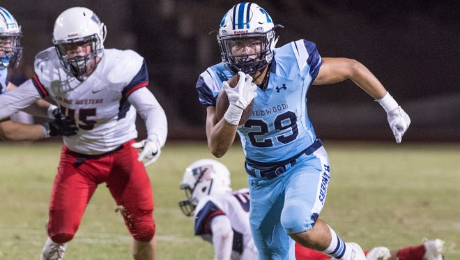 Redwood's Alex Rivera runs against Tulare Western in a non-league high school football game on Friday, September 15, 2017.