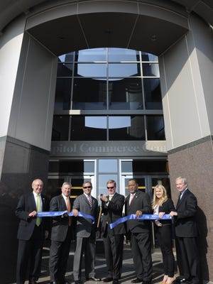 Hancock Bank officials open a new corporate hub in Montgomery in 2013.