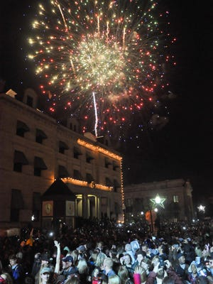 Fireworks erupt over Palafox Place during a previous Pensacola Pelican Drop.