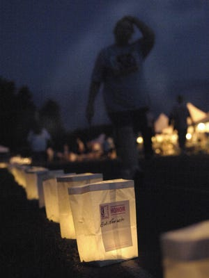 Luminaries line the track used for the Portage County Relay for Life walk for American Cancer Society.
