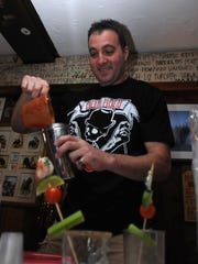 In this file photo, Bobby Riccio, of Oasis Bar 'N' Grill works on his winning drink recipe during a Bloody Mary competition on May 18, 2008.