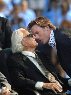 The Rev. Billy Graham is greeted by singer Michael W. Smith on June 26, 2005, in New York City.