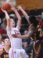 Marist College's Madeline Blais, left, tries going for a shot as Iona College's Joy Adams, right, throws up a block.