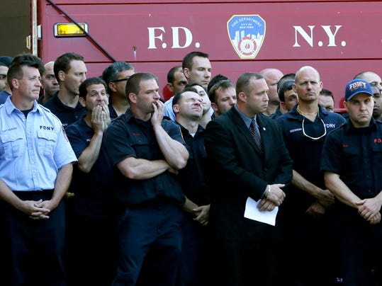 APTOPIX NYC Firefighter Killed