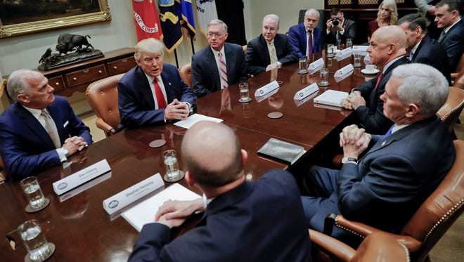 President Donald Trump, left, and Vice President Mike Pence, right, participate in a meeting with health insurance company executives in the Roosevelt Room of the White House in Washington on Monday, Feb. 27, 2017.