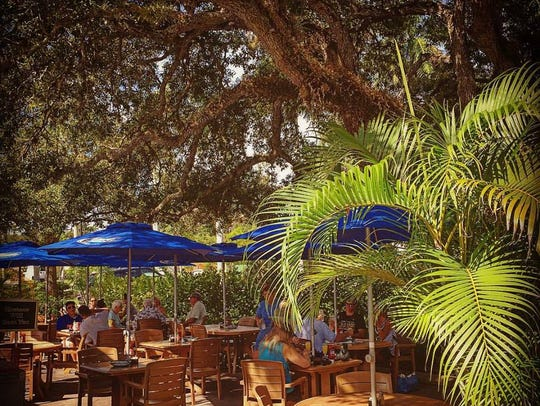 The oak-shaded patio at McGregor Cafe in Fort Myers.