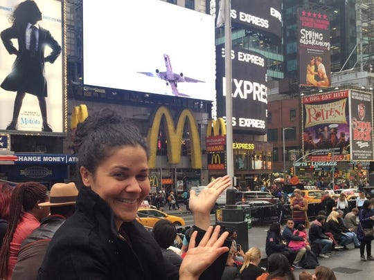 """Alexandria Wailes in New York's Times Square in 2015 with her """"Spring Awakening"""" billboard in the background."""
