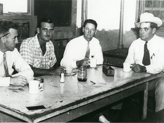 Jailed on contempt of court charges, (from left) reporter Tom Mulvaney, Managing Editor Bob McCracken, and Publisher Conway C. Craig join Nueces County Sheriff John Harney for coffee in the jail 's kitchen. Photo by Kay McCracken