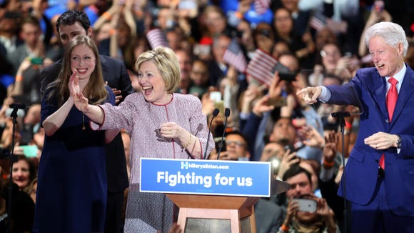 Hillary Clinton, along with Bill Clinton and their daughter Chelsea acknowledge the cheers of supporters at the Sheraton New York in Manhattan after Clinton defeated Bernie Sanders in the New York primary April 19, 2016.