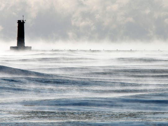A lighthouse is mired in a depth of winter along Lake
