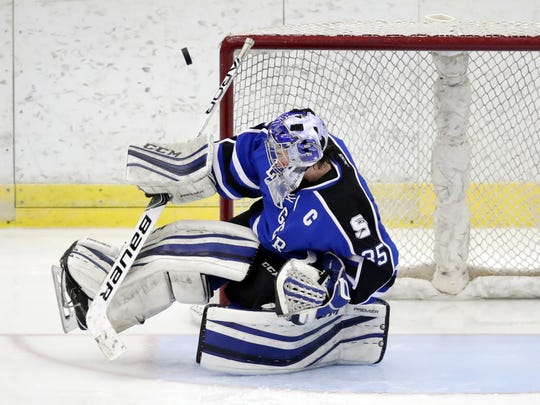 Saint Mary's Springs goaltender Colin Ahern blocks a shot during a WIAA state quarterfinal against Hudson on  Thursday at the Veterans Memorial Coliseum in Madison.