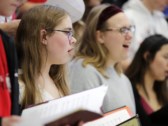 Makenna Kraus, a junior at Kimberly High School, rehearses with the  concert choir as part of preparations for a show at Carnegie Hall in New York City. Danny Damiani/USA TODAY NETWORK-Wisconsin