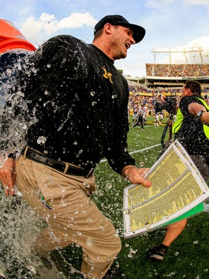 503102704.jpg ORLANDO, FL - JANUARY 01: Head coach Jim Harbaugh of the Michigan Wolverines is dumped with water after the Buffalo Wild Wings Citrus Bowl game against the Florida Gators at Orlando Citrus Bowl on January 1, 2016 in Orlando, Florida.