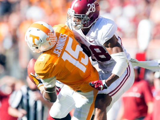 Alabama defensive back Anthony Averett, right, breaks