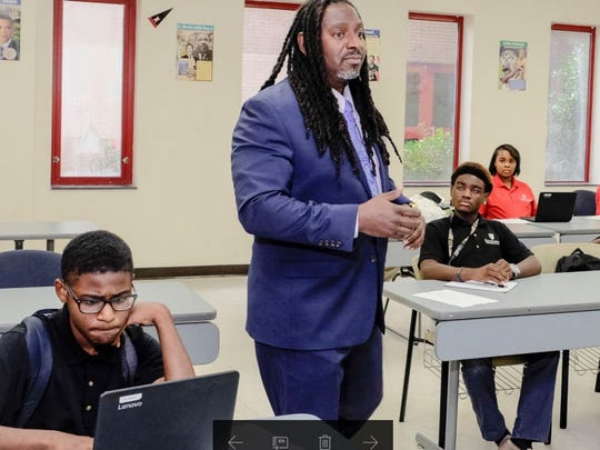 U.S. history teacher Dr Kirkland Hamilton is on his feet and is constantly in motion in his classroom at Southwest Early College.